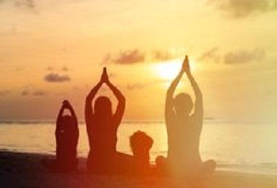 family-silhouettes-doing-yoga-at-sunset-56771760.jpg